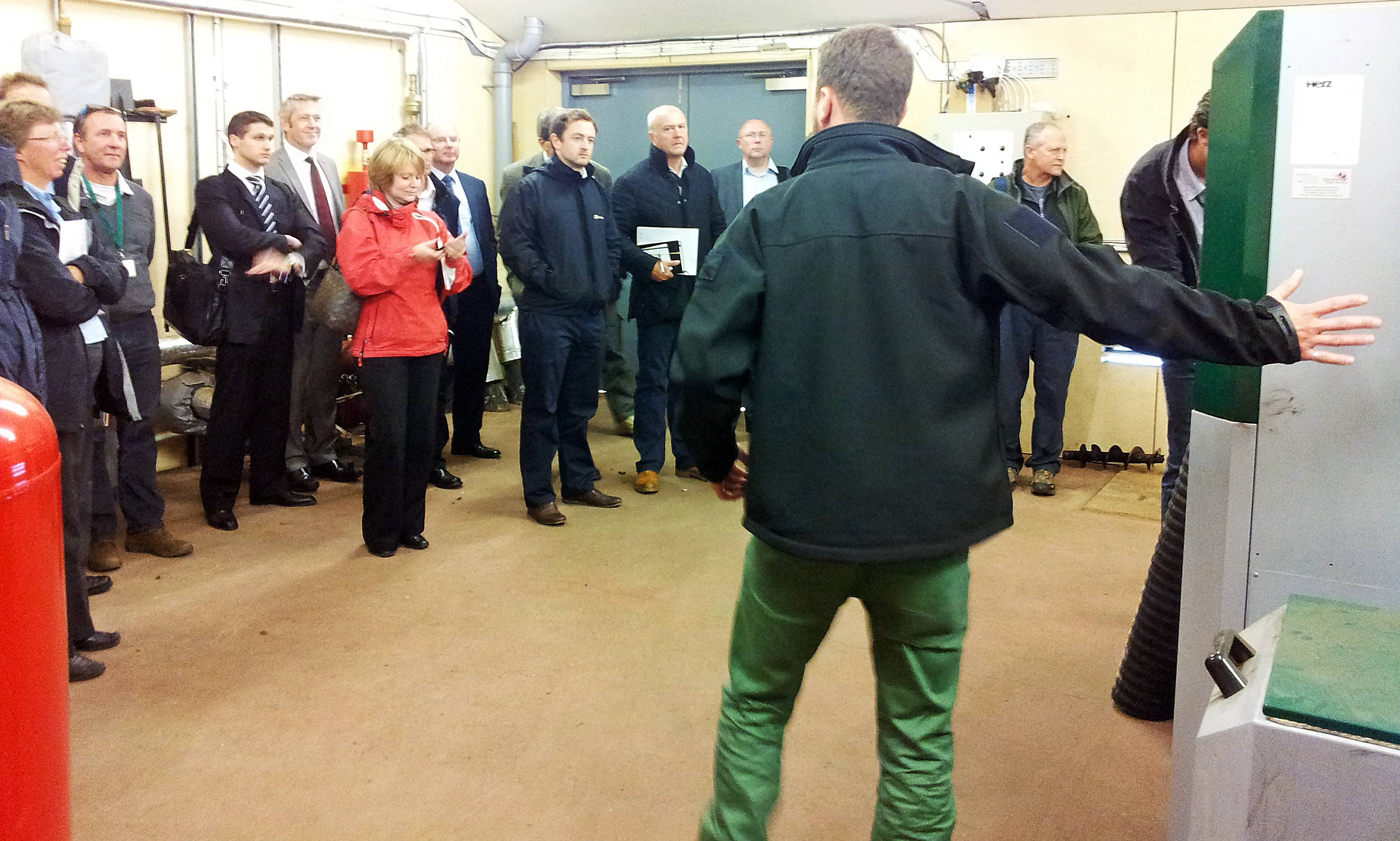 Delegates learn more about the Herz BioMatic biomass boiler in situ