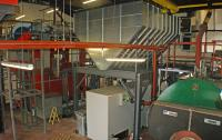 The fuel store and biomass boiler in the plant room
