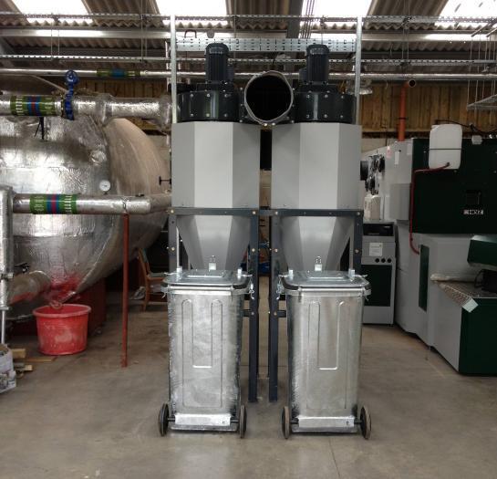 The biomass plant room, ash bins, buffer tank and Herz BioFire